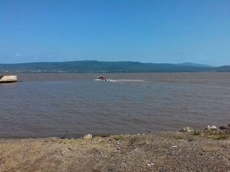 Переправа через Амур на моторной лодке. Crossing the Amur by motor boat.