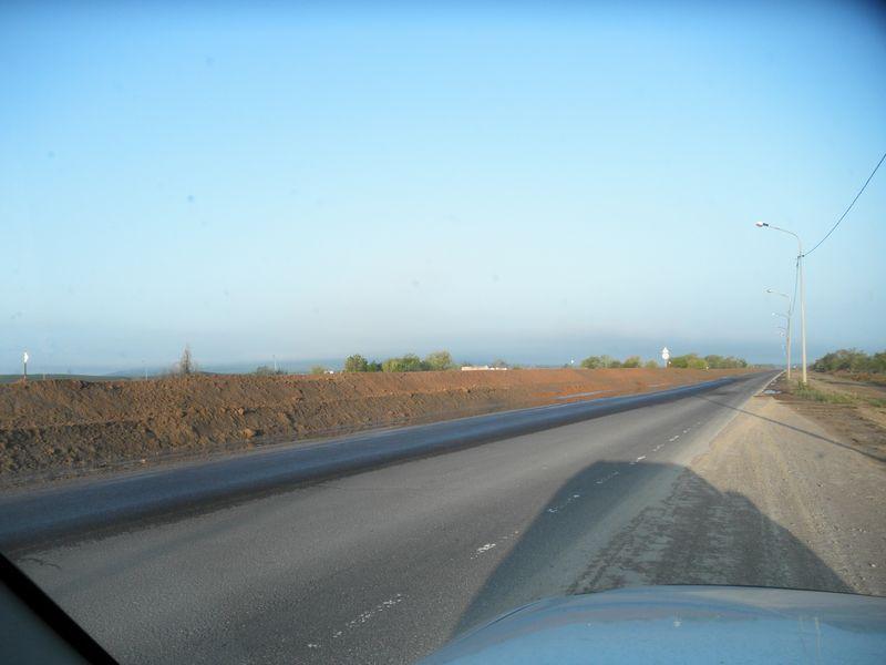 Строительство новой дороги от Алматы до Кордая. Construction of a new road from Almaty to Korday.